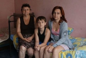 Fleeing 'place full of death,' Jews from eastern Ukraine weep for homeland