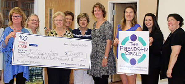 Pictured, celebrating the donation, from left, were Peg Donovan, Cara Kennedy, Marcy O'Hare, Sandra Alinger, Iva Zornow, Sheila Seeley, Lacey Lautenschlager, Chaya Rubin, and Sherry Ashery.