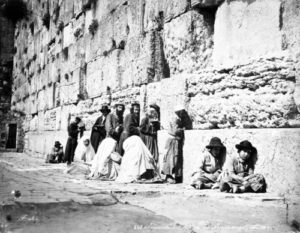 Jewish worshipers at the Western Wall in the 1870s.  Photo Courtesy Of Wikimedia Commons.