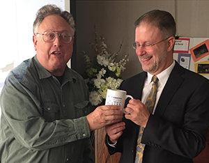 Breakfast-and-A-Speaker Program Chairperson Bob Michaels, left, presents CGOH Brotherhood mug to presenter Harris Oberlander, CEO of Trinity Alliance in Albany.  Photo by Jonathan Kipp, brotherhood board member.