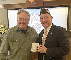 Breakfast-and-A-Speaker Program Chairperson Bob Michaels presents the Congregation Gates of Heaven  (CGOH) Brotherhood mug to Col. Richard Goldenberg. Photo by CGOH Brotherhood Board Member Jonathan Kipp.