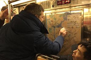 NY commuters clean Nazi graffiti off subway car